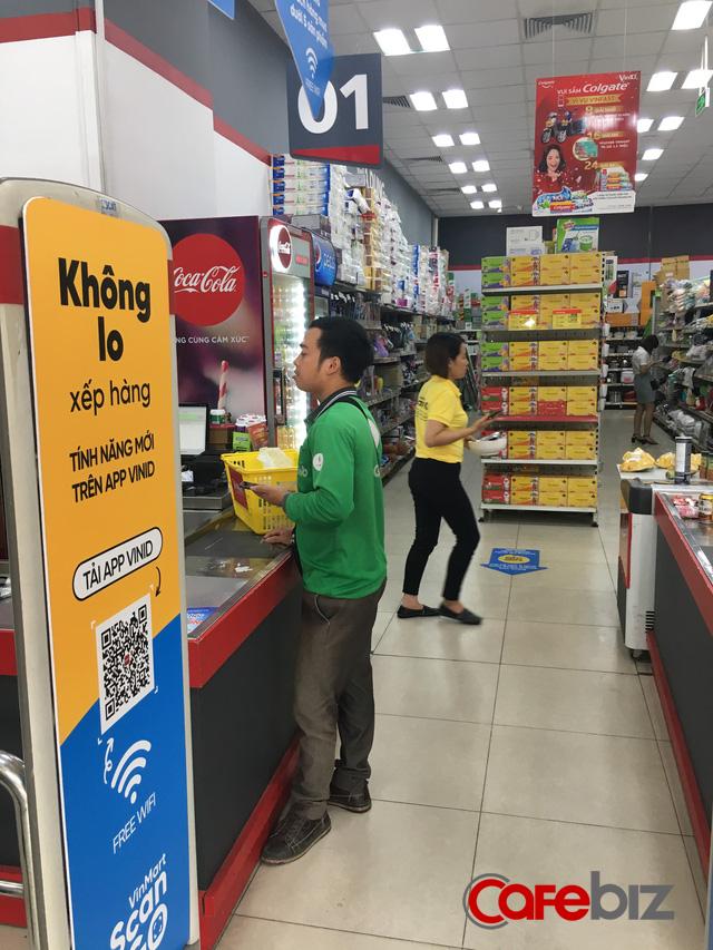 Khi gã khổng lồ Vingroup bắt tay Grab: 1 người khỏe, 2 người vui và những chuyến xe giúp Vinmart tiến gần ngôi vương thị trường TMĐT Việt Nam - Ảnh 2.