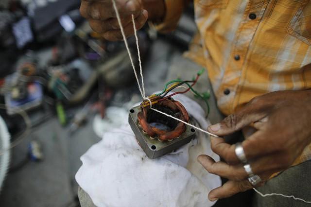 Lâm cảnh khó khăn, người dân Venezuela tích cực dùng đồ tái chế - Ảnh 5.