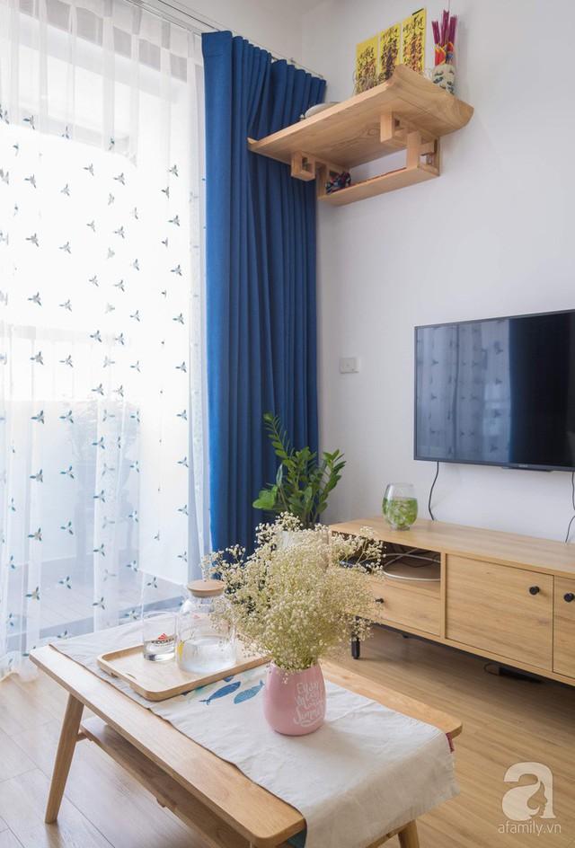 Căn hộ 66m² trên tầng cao với thiết kế đơn giản ở quận Thanh Xuân của gia chủ yêu màu xanh biển - Ảnh 4.