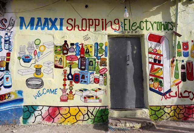 Tỷ lệ mù chữ quá cao, biển quảng cáo ở Somali chủ yếu là hình vẽ không cần đọc nhìn là hiểu - Ảnh 11.