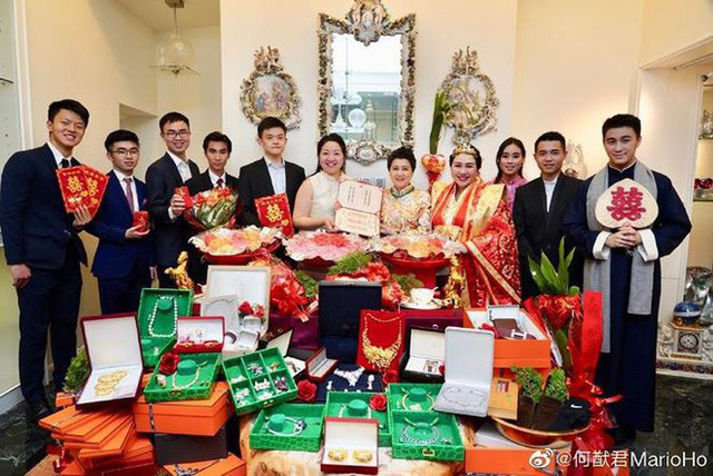 Choáng với sính lễ toàn vàng ròng trong đám cưới con gái 'vua sòng bạc Macau' - Ảnh 1.