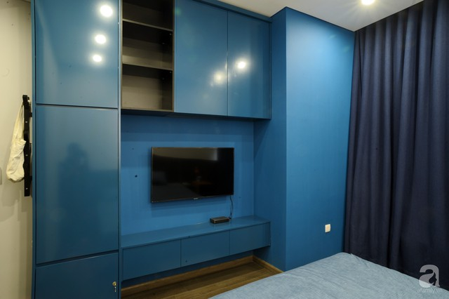 Căn hộ 90m² đẹp hiện đại với điểm nhấn màu xanh rất nam tính, có chi phí thi công 280 triệu đồng ở Hà Nội - Ảnh 13.