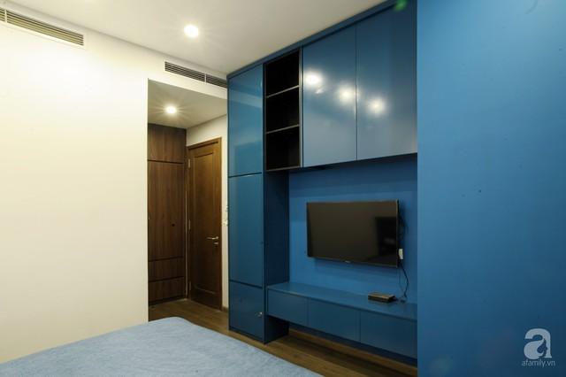 Căn hộ 90m² đẹp hiện đại với điểm nhấn màu xanh rất nam tính, có chi phí thi công 280 triệu đồng ở Hà Nội - Ảnh 14.
