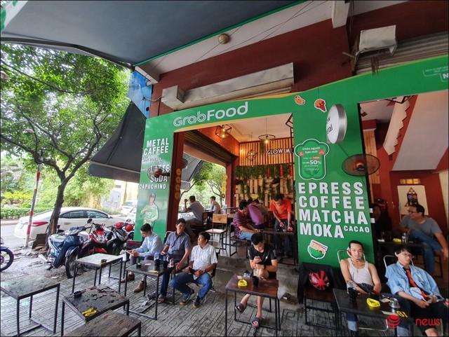 GrabFood mở quán cà phê ở Sài Gòn? - Ảnh 1.