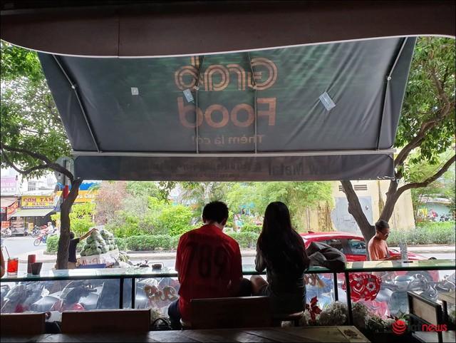 GrabFood mở quán cà phê ở Sài Gòn? - Ảnh 3.