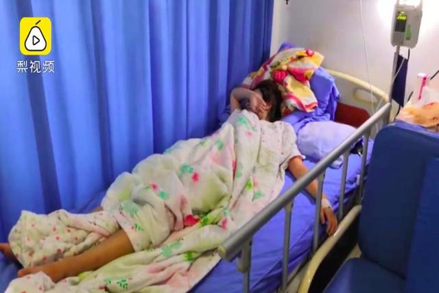 Hai cô gái Trung Quốc nhập viện sau thử thách 1.000 cái squat - Ảnh 1.