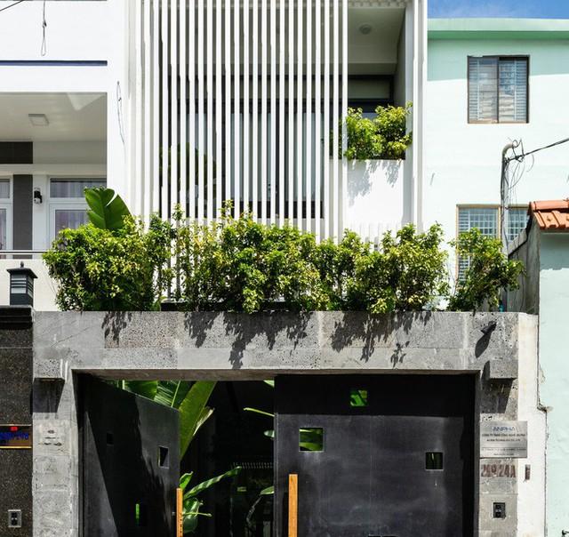 Không cần đập đi xây lại, căn nhà 5 người ở vẫn trở thành tòa văn phòng hạng sang - Ảnh 1.