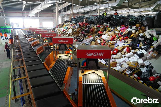 GHN ra mắt hệ thống phân loại hàng tự động 100% lớn nhất tại Việt Nam: Năng suất 30.000 đơn/giờ, tiết kiệm 600 nhân công, rút ngắn thời gian từ 3 giờ còn 30 phút - Ảnh 2.