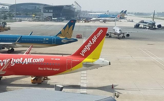 Ngừng tất cả chuyến bay đến vùng có dịch virus Corona ở Trung Quốc - Ảnh 1.