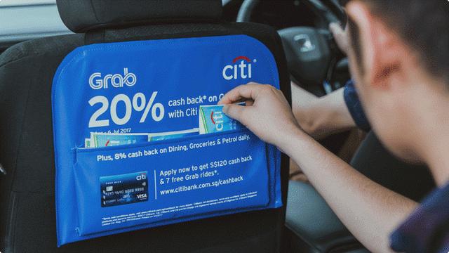 Sự nguy hiểm của những mảng kinh doanh phụ: Cho dán banner trên thân xe, chạy video quảng cáo sau ghế, Grab kiếm hàng trăm triệu USD mỗi năm - Ảnh 1.