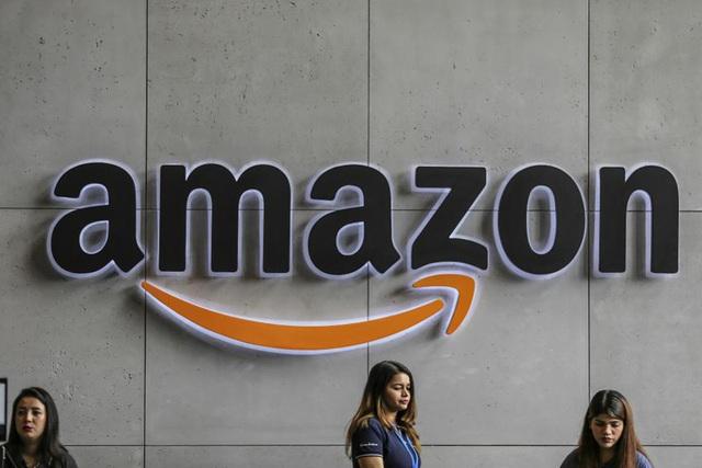 Nhu cầu tăng vọt giữa dịch Covid-19, Amazon tuyển dụng hơn 100.000 nhân viên mới - Ảnh 1.