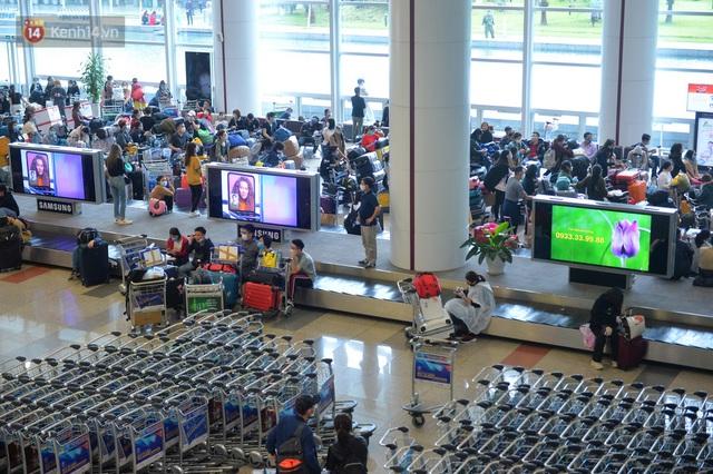 Ảnh: Cận cảnh quy trình lấy mẫu xét nghiệm Covid-19 trực tiếp tại sân bay Nội Bài - Ảnh 12.