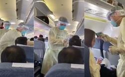 Video từ tâm dịch Vũ Hán: Nhân viên y tế Trung Quốc mặc đồ chống virus kín người, quét thân nhiệt hành khách trên máy bay