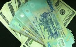 Giá USD đang trượt dốc trên thị trường thế giới, trong nước vẫn ổn định
