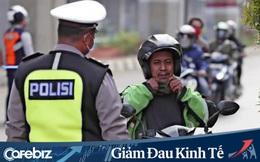Grab và Gojek 'đốt tiền' cứu tài xế