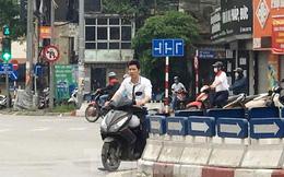 Nhiều người Hà Nội lơ là không đeo khẩu trang, 'lượn lờ' giữa phố đông