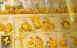 Vàng giảm giá do chịu sức ép của đồng USD