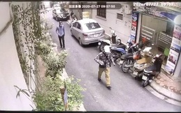 Hình ảnh 2 đối tượng dùng súng cướp 942 triệu đồng chi nhánh ngân hàng BIDV ở Hà Nội