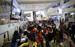 Ảnh: Sân bay Nội Bài vắng vẻ cân Tết Nguyên Đán, khác hẳn cảnh tượng đông đúc mọi năm