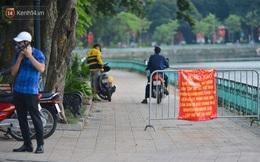 Ảnh: Bất chấp quy định, hàng trăm người dân vẫn vượt rào tập thể dục, chụp ảnh ở hồ Tây