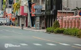 """Đường phố Sài Gòn vắng lặng chưa từng thấy trong ngày đầu siết chặt giãn cách: Không còn bóng shipper, """"ai ở đâu ở yên đó"""""""