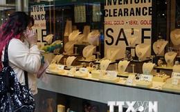 Giá vàng thế giới giảm xuống mức thấp nhất trong năm năm qua