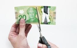 Muốn thúc đẩy kinh tế, hãy... cắt tiền làm đôi theo đúng nghĩa đen