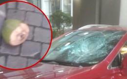 Hà Nội: Vỏ dừa từ trên chung cư rơi xuống khiến một ô tô vỡ tan kính trước