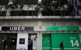 Singapore: Thương vụ Grab mua Uber không bị hủy bỏ