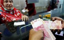 Doanh nghiệp và người tiêu dùng châu Á khốn khổ khi đồng nội tệ mất giá