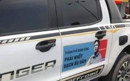 Người dân dán hình nghi phạm dâm ô trẻ em Nguyễn Hữu Linh lên ô tô diễu phố