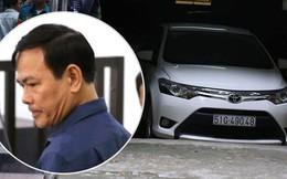 Ông Nguyễn Hữu Linh rời khỏi tòa bằng ô tô riêng sau khi bị tuyên án 18 tháng tù