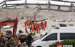 Dưới đống đổ nát của khách sạn cách ly ở Trung Quốc: Người đến từ vùng dịch chưa được giải cứu, người nằm bên chân con đợi đoàn tụ chồng