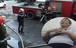 Bị kẹt trong vụ cháy ở tầng 18 chung cư, cặp vợ chồng già dùng khăn ướt, băng dính cầm cự