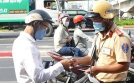 CSGT Tp.HCM phạt hơn 600 triệu đồng, tước hơn 400 giấy phép lái xe trong 3 ngày đầu ra quân